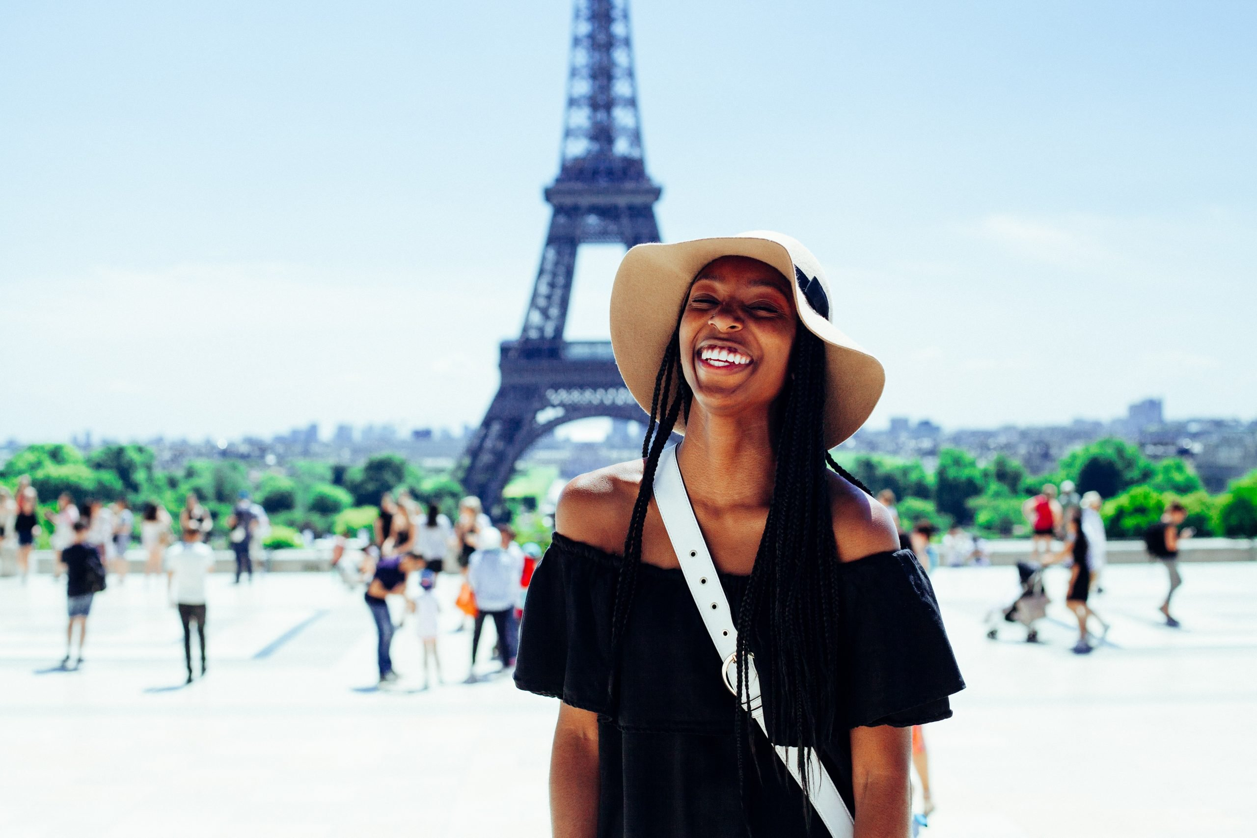 College Girl Smiling in front of the Eiffel Tower in Paris